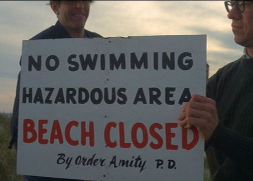 "The ""No Swimming / Hazardous Area / Beach Closed / By order Amity P.D"" sign as depicted in the film."