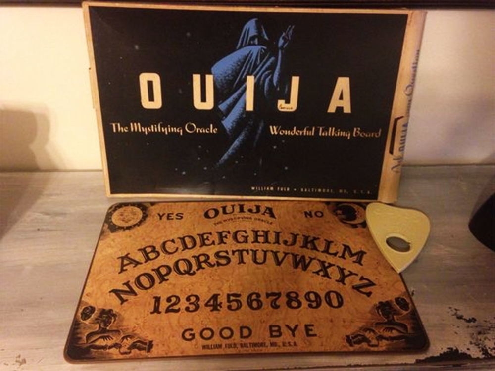 A pre-Parker Brothers Ouija box, board, and planchette.